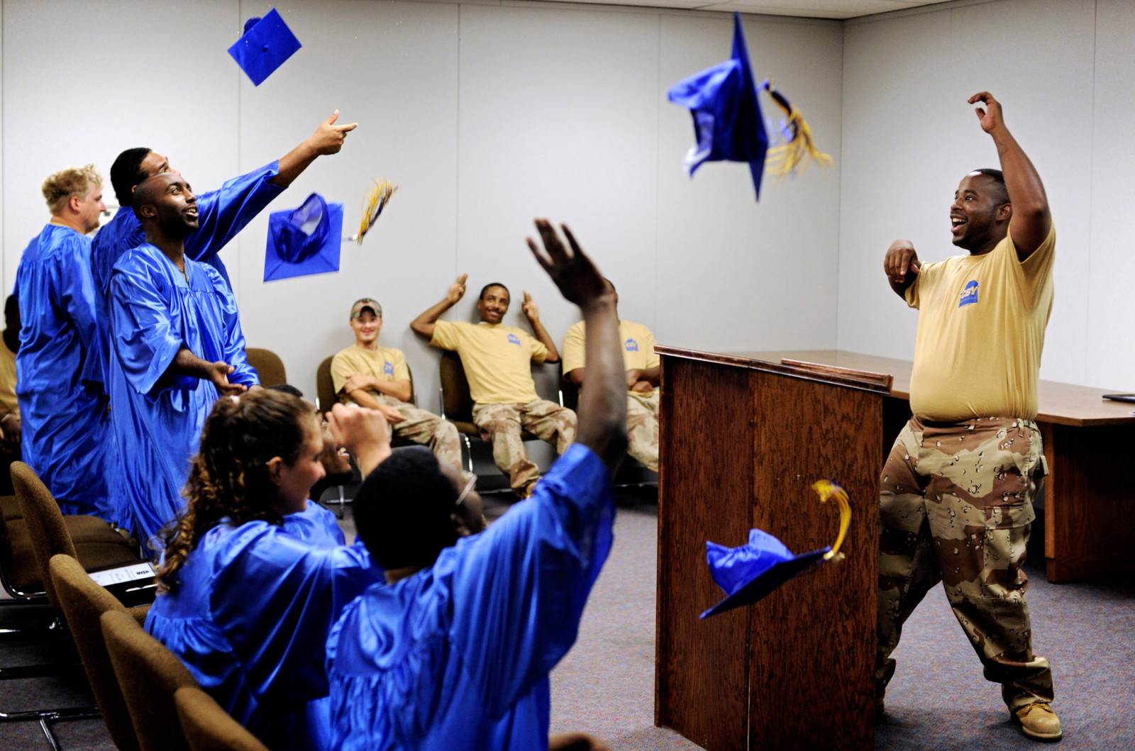 Eight participants of Columbia Builds Youth celebrate at the conclusion of their graduation ceremony. CBY, a branch of the national/global YouthBuild program, teaches construction skills to young people ages 16 to 24 while helping them earn their GED...