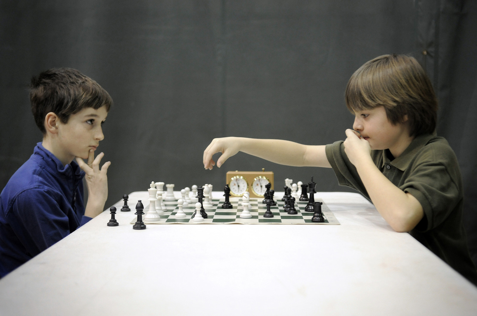 Zane Durante waits for defending champion Grant Roulier to make a move during the tie-breaking championship match at the annual Columbia Open Chess Tournament at Gentry Middle School.