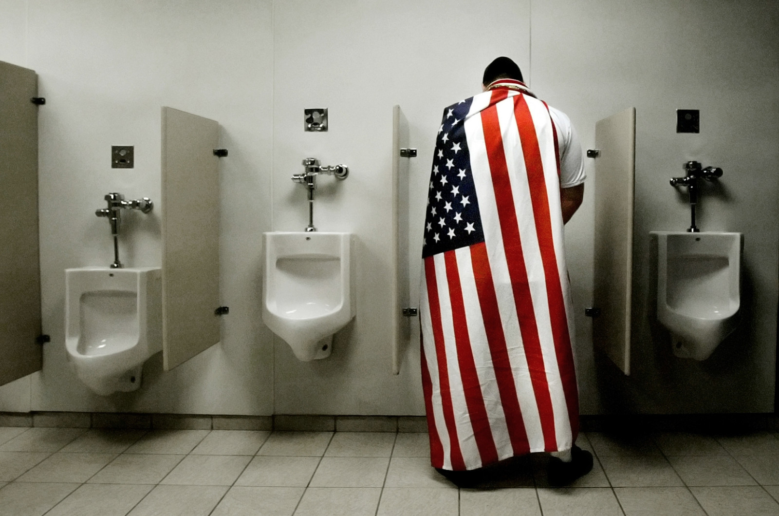 Bobby Poole of Overland Park, KS, takes a bathroom break during halftime of the World Cup watch party at Arrowhead Stadium Pavillion, Thursday, June 22, 2006, In Kansas City, Mo. Ghana defeated the U.S. 2-1.
